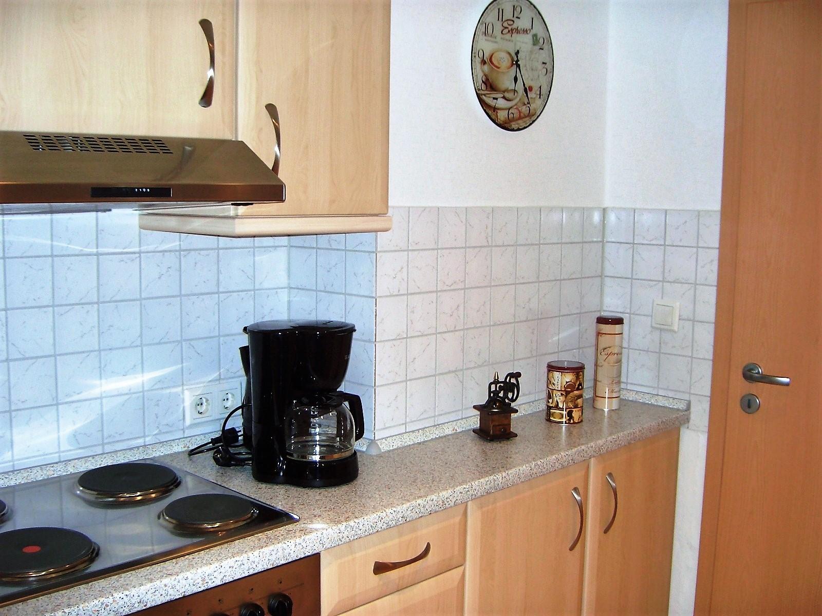 Foto Küche Kaffemaschine und Herd