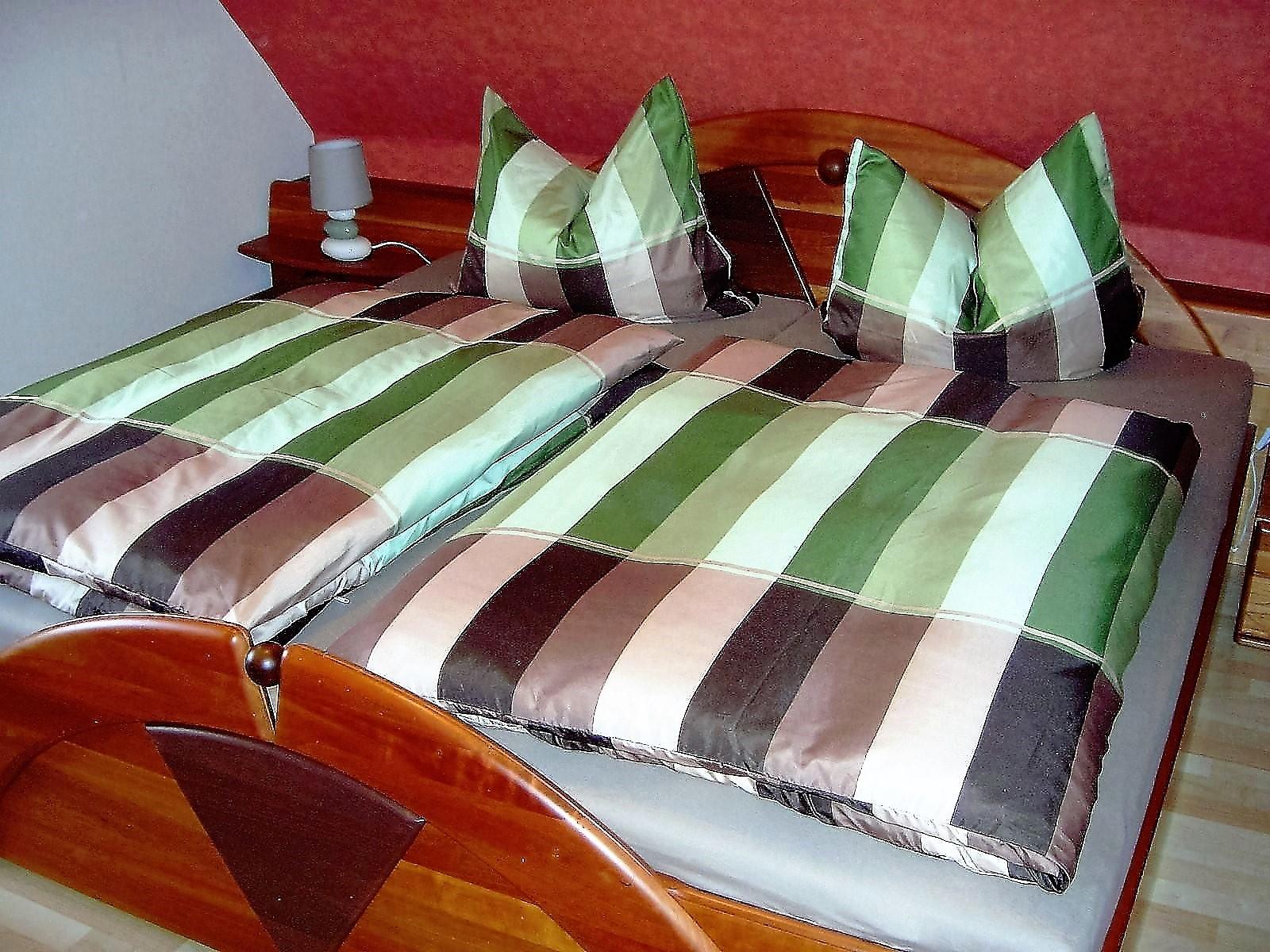 Foto vom bett im Schlafzimmer